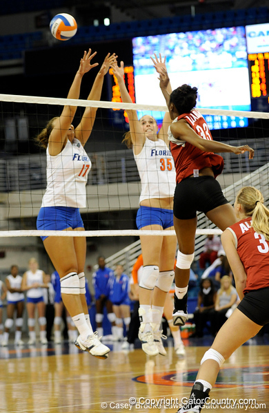 UF sophomore Lauren Bledsoe and senior Kelsey Bowers unsuccessfully attempt to block a shot by an Alabama player during the second set. The Gators clinched their last home game with a 3-0 win over the Crimson Tide at the O'Connell Center on Saturday, November 23, 2008. (Casey Brooke Lawson / Gator Country)