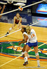 UF freshman Colleen Ward hits the ball over her teammate freshman middle blocker Cassandra Anderson during the third set. The Gators clinched their last home game with a 3-0 win over the Crimson Tide at the O'Connell Center on Saturday, November 23, 2008. (Casey Brooke Lawson / Gator Country)