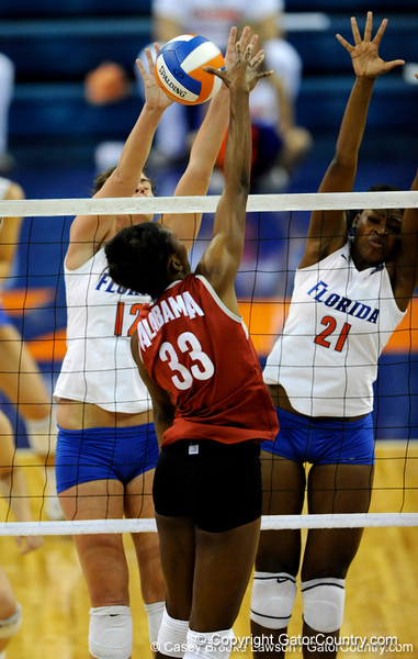UF sophomore Lauren Bledsoe and freshman Cassandra Anderson jump to block the ball in the first set. The Gators clinched their last home game with a 3-0 win over the Crimson Tide at the O'Connell Center on Saturday, November 23, 2008. (Casey Brooke Lawson / Gator Country)