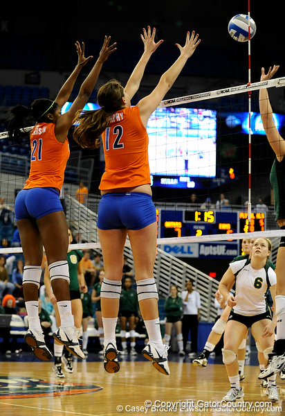 UF freshman Cassandra Anderson and freshman Kelly Murphy jump up to block a shot made by Colorado State. The Gator's were triumphant over the Rams 3-0 in Gainesville, Fla on December 6, 2008. (Casey Brooke Lawson)