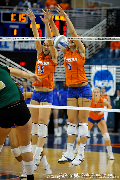 UF senior Kelsey Bowers and sophomore Callie Rivers jump up to block a shot made by a Colorado State player. The Gator's were triumphant over the Rams 3-0 in Gainesville, Fla on December 6, 2008. (Casey Brooke Lawson)