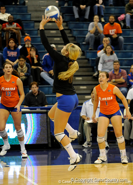 UF junior Elyse Cusack hits the ball over the net to Colorado State. The Gator's were triumphant over the Rams 3-0 in Gainesville, Fla on December 6, 2008. (Casey Brooke Lawson)