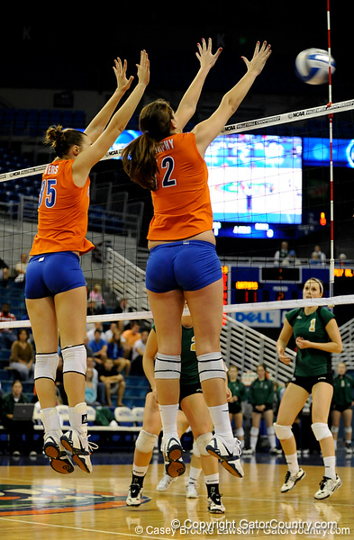 UF senior Kelsey Bowers and freshman Kelly Murphy jump up to block a shot by Colorado State. The Gator's were triumphant over the Rams 3-0 in Gainesville, Fla on December 6, 2008. (Casey Brooke Lawson)