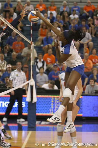 Florida sophomore middle blocker Cassandra Anderson makes an attack during the Gators' 3-0 win against the Auburn Tigers on Sunday, November 8, 2009 at the Stephen C. O'Connell Center in Gainesville, Fla. / Gator Country photo by Tim Casey