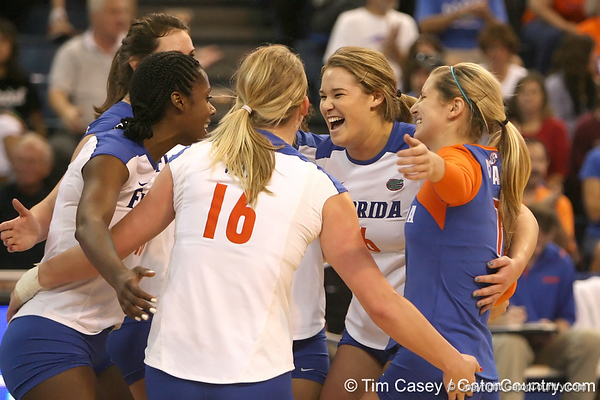 Florida redshirt-sophomore outside hitter Kristy Jaeckel celebrates with teammates during the Gators' 3-0 win against the Auburn Tigers on Sunday, November 8, 2009 at the Stephen C. O'Connell Center in Gainesville, Fla. / Gator Country photo by Tim Casey