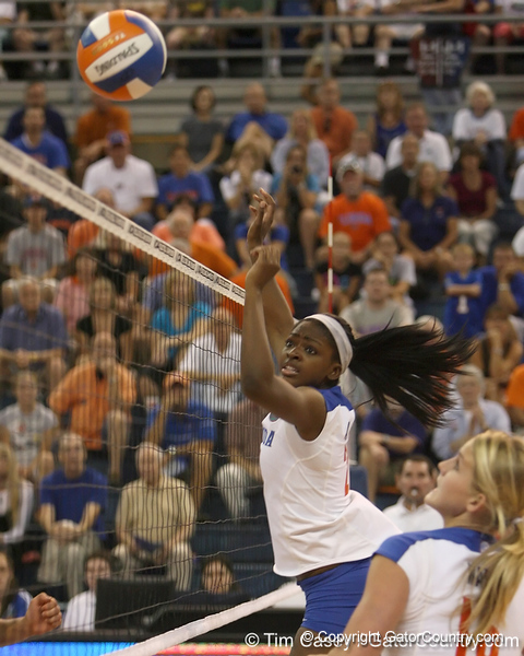 Florida sophomore middle blocker Cassandra Anderson watches the ball during the Gators' 3-0 win against the Colorado Buffaloes on Saturday, August 29, 2009 at the Stephen C. O'Connell Center in Gainesville, Fla / Gator Country photo by Tim Casey