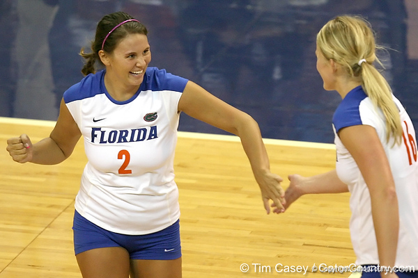 Florida junior setter Brynja Rodgers celebrates with Colleen Ward during the Gators' 3-0 win against the Colorado Buffaloes on Saturday, August 29, 2009 at the Stephen C. O'Connell Center in Gainesville, Fla / Gator Country photo by Tim Casey