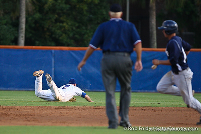 Florida senior Josh Adams stops a ground ball during the Gators' 4-1 victory over the University of North Florida Ospreys on Wednesday, May 11, 2011 at McKethan Stadium in Gainesville, Fla. / photo by Rob Foldy