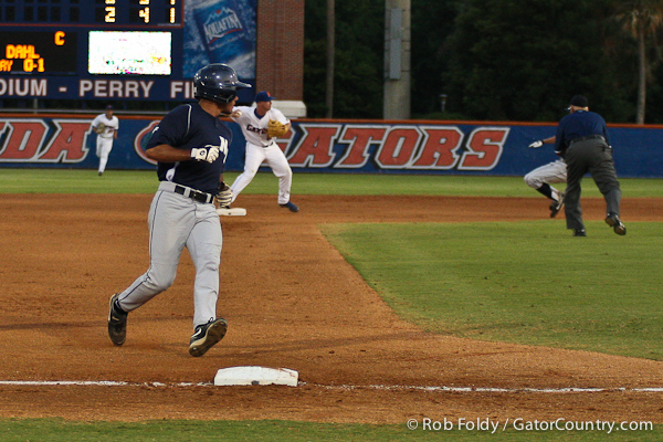 Florida senior Josh Adams turns a double play during the Gators' 4-1 victory over the University of North Florida Ospreys on Wednesday, May 11, 2011 at McKethan Stadium in Gainesville, Fla. / photo by Rob Foldy