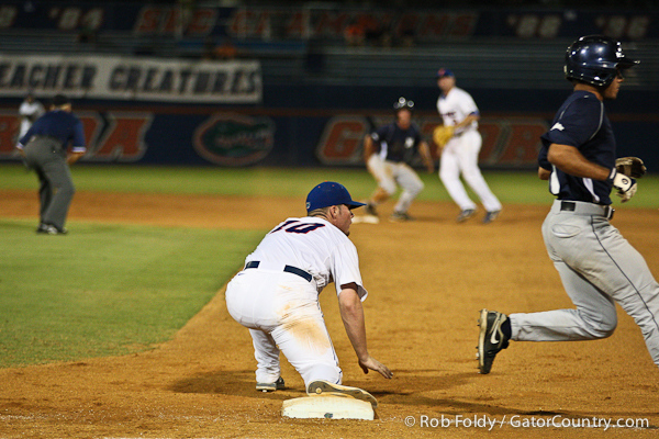 Florida sophomore Austin Maddox looks for the umpire's call during a double play attempt during the Gators' 4-1 victory over the University of North Florida Ospreys on Wednesday, May 11, 2011 at McKethan Stadium in Gainesville, Fla. / photo by Rob Foldy