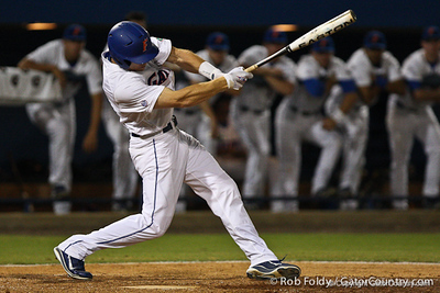 Florida senior Bryson Smith follows through with a swing during the Gators' 4-1 victory over the University of North Florida Ospreys on Wednesday, May 11, 2011 at McKethan Stadium in Gainesville, Fla. / photo by Rob Foldy