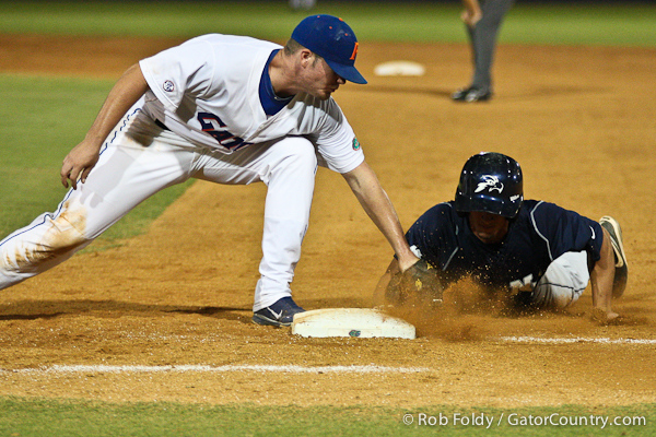 Florida sophomore Austin Maddox attempts to pickoff the UNF runner during the Gators' 4-1 victory over the University of North Florida Ospreys on Wednesday, May 11, 2011 at McKethan Stadium in Gainesville, Fla. / photo by Rob Foldy