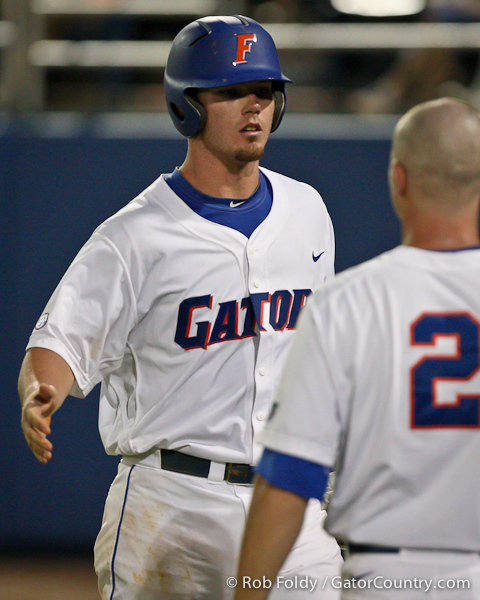 Florida sophomore Austin Maddox gets congratulated by senior Josh Adams after hitting a 2-run homer during the Gators' 4-1 victory over the University of North Florida Ospreys on Wednesday, May 11, 2011 at McKethan Stadium in Gainesville, Fla. / photo by Rob Foldy
