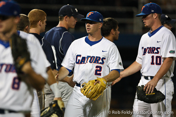 Florida senior Josh Adams and teammates shook hands with the Osprey players after the Gators' 4-1 victory over the University of North Florida on Wednesday, May 11, 2011 at McKethan Stadium in Gainesville, Fla. / photo by Rob Foldy