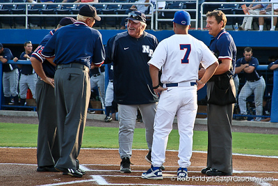 Florida baseball head coach Kevin O'Sullivan and UNF coach Smoke Lavel meet with the umpires before the Gators' 4-1 victory over the University of North Florida Ospreys on Wednesday, May 11, 2011 at McKethan Stadium in Gainesville, Fla. / photo by Rob Foldy