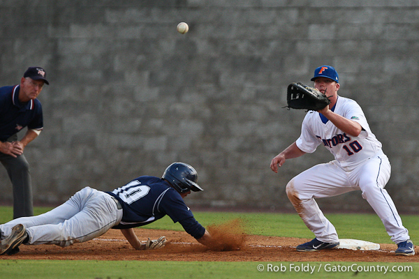 Florida sophomore Austin Maddox attempting to pick off UNF junior T.J. Gavlik during the Gators' 4-1 victory over the University of North Florida Ospreys on Wednesday, May 11, 2011 at McKethan Stadium in Gainesville, Fla. / photo by Rob Foldy