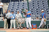 Florida baseball volunteer assistant coach Don Norris launches fly balls during the Men's College World Series practice day on Friday, June 17, 2011 at TD Ameritrade Park in Omaha, Neb. / Gator Country photo by Tim Casey