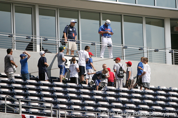 Florida baseball head coach Kevin O'Sullivan signs an autograph during the Men's College World Series practice day on Friday, June 17, 2011 at TD Ameritrade Park in Omaha, Neb. / Gator Country photo by Tim Casey