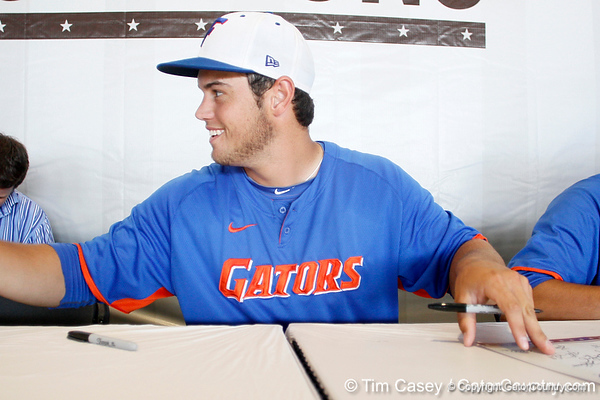 Florida junior right fielder Preston Tucker signs an autograph during the Men's College World Series practice day on Friday, June 17, 2011 at TD Ameritrade Park in Omaha, Neb. / Gator Country photo by Tim Casey