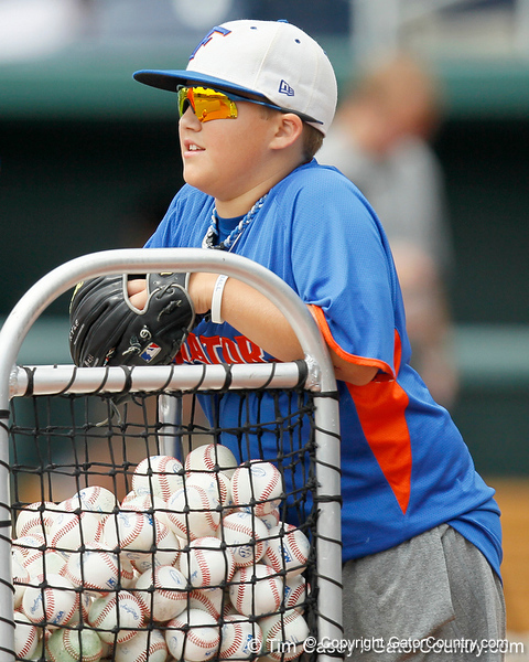 Florida's batboy looks on during the Men's College World Series practice day on Friday, June 17, 2011 at TD Ameritrade Park in Omaha, Neb. / Gator Country photo by Tim Casey