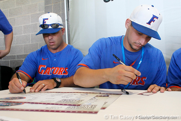 Florida baseball head coach Kevin O'Sullivan and sophomore catcher Mike Zunino sign autographs during the Men's College World Series practice day on Friday, June 17, 2011 at TD Ameritrade Park in Omaha, Neb. / Gator Country photo by Tim Casey