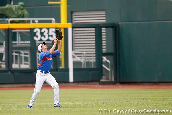 Florida redshirt junior outfielder Paul Wilson catches a fly ball during the Men's College World Series practice day on Friday, June 17, 2011 at TD Ameritrade Park in Omaha, Neb. / Gator Country photo by Tim Casey
