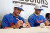Florida redshirt junior outfielder Paul Wilson and freshman pitcher Karsten Whitson sign autographs during the Men's College World Series practice day on Friday, June 17, 2011 at TD Ameritrade Park in Omaha, Neb. / Gator Country photo by Tim Casey