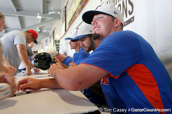 Florida sophomore Austin Maddox signs an autograph during the Men's College World Series practice day on Friday, June 17, 2011 at TD Ameritrade Park in Omaha, Neb. / Gator Country photo by Tim Casey