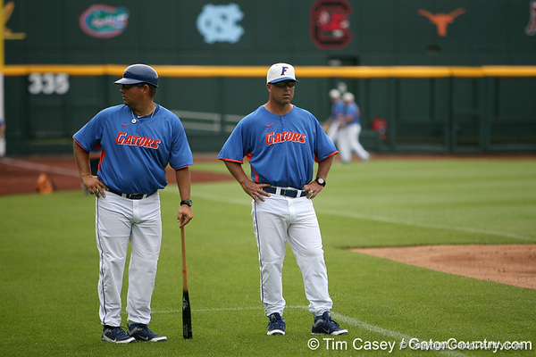 Florida baseball assistant coach Craig Bell and head coach Kevin O'Sullivan look on during the Men's College World Series practice day on Friday, June 17, 2011 at TD Ameritrade Park in Omaha, Neb. / Gator Country photo by Tim Casey