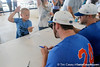 A fan does the Gator chomp while Florida junior pitcher Alex Panteliodis signs an autograph during the Men's College World Series practice day on Friday, June 17, 2011 at TD Ameritrade Park in Omaha, Neb. / Gator Country photo by Tim Casey