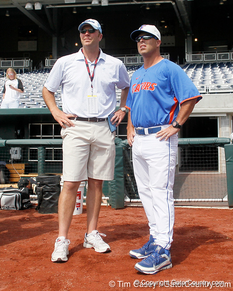 ESPN analyst Kyle Peterson speaks with Florida baseball head coach Kevin O'Sullivan during the Men's College World Series practice day on Friday, June 17, 2011 at TD Ameritrade Park in Omaha, Neb. / Gator Country photo by Tim Casey