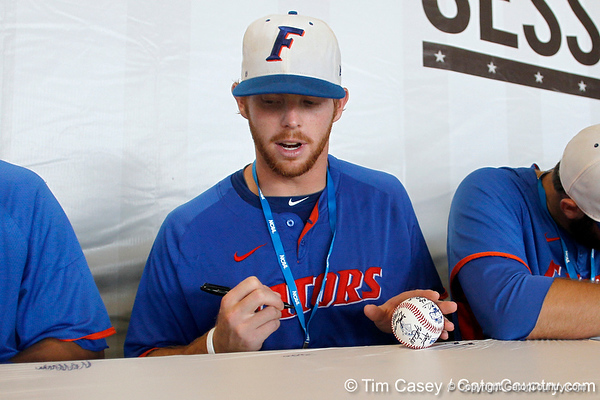 Florida senior Bryson Smith signs an autograph during the Men's College World Series practice day on Friday, June 17, 2011 at TD Ameritrade Park in Omaha, Neb. / Gator Country photo by Tim Casey