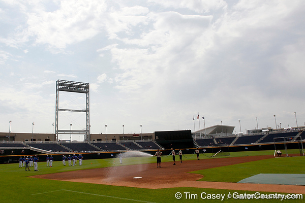 The grounds crew prepares the field during the Men's College World Series practice day on Friday, June 17, 2011 at TD Ameritrade Park in Omaha, Neb. / Gator Country photo by Tim Casey