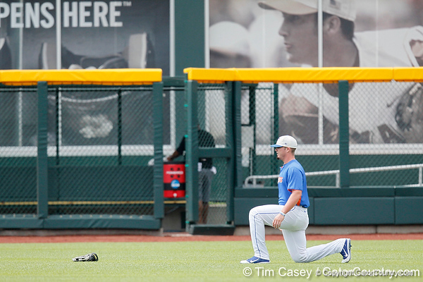 Florida sophomore Austin Maddox stretches during the Men's College World Series practice day on Friday, June 17, 2011 at TD Ameritrade Park in Omaha, Neb. / Gator Country photo by Tim Casey