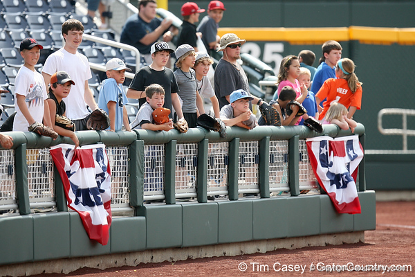 Fans wait for foul balls during the Men's College World Series practice day on Friday, June 17, 2011 at TD Ameritrade Park in Omaha, Neb. / Gator Country photo by Tim Casey