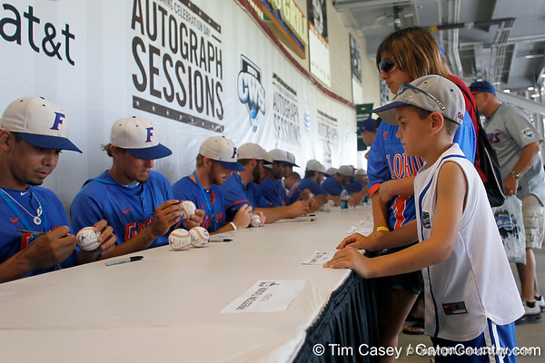 Florida junior outfielder Tyler Thompson signs an autograph for a Gators fan during the Men's College World Series practice day on Friday, June 17, 2011 at TD Ameritrade Park in Omaha, Neb. / Gator Country photo by Tim Casey
