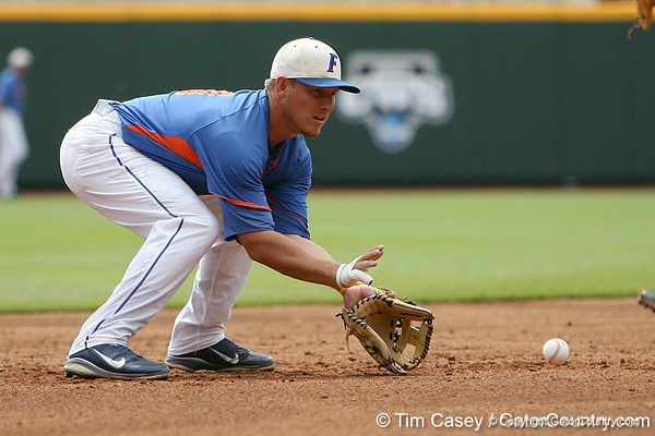 Florida junior infielder Jeff Moyer fields a ground ball during the Men's College World Series practice day on Friday, June 17, 2011 at TD Ameritrade Park in Omaha, Neb. / Gator Country photo by Tim Casey
