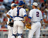 Florida head coach Kevin O'Sullivan talks with Mike Zunino and Josh Adams during the Gators' 8-4 win against the Texas Longhorns in the College World Series on Saturday, June 18, 2011 at TD Ameritrade Park in Omaha, Neb. / Gator Country photo by Tim Casey