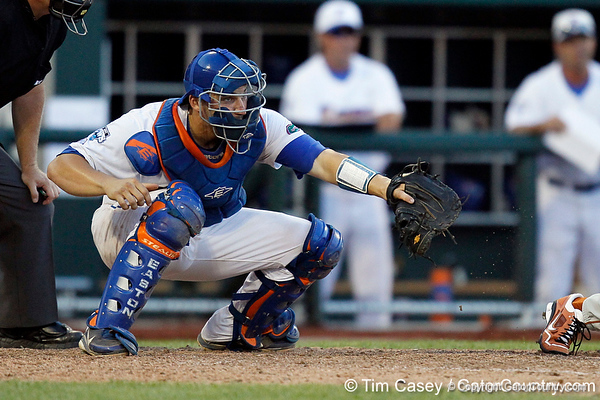 Florida sophomore catcher Mike Zunino catches a pitch during the Gators' 8-4 win against the Texas Longhorns in the College World Series on Saturday, June 18, 2011 at TD Ameritrade Park in Omaha, Neb. / Gator Country photo by Tim Casey