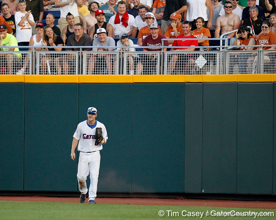 Florida junior outfielder Daniel Pigott reacts after getting tricked by a fan during the Gators' 8-4 win against the Texas Longhorns in the College World Series on Saturday, June 18, 2011 at TD Ameritrade Park in Omaha, Neb. / Gator Country photo by Tim Casey