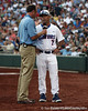 ESPN reporter Kyle Peterson talks with Florida head coach Kevin O'Sullivan during the Gators' game against the Texas Longhorns in the College World Series on Saturday, June 18, 2011 at TD Ameritrade Park in Omaha, Neb. / Gator Country photo by Tim Casey