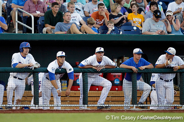 Nolan Fontana, Preston Tucker, Zack Powers and Jeff Moyer watch during the Gators' 8-4 win against the Texas Longhorns in the College World Series on Saturday, June 18, 2011 at TD Ameritrade Park in Omaha, Neb. / Gator Country photo by Tim Casey