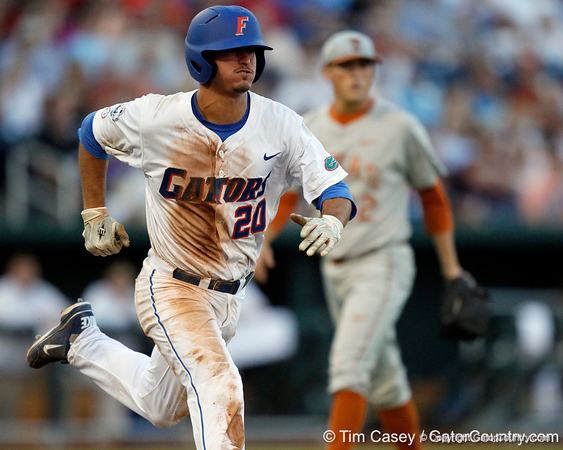Florida sophomore infielder Cody Dent runs to first base during the Gators' 8-4 win against the Texas Longhorns in the College World Series on Saturday, June 18, 2011 at TD Ameritrade Park in Omaha, Neb. / Gator Country photo by Tim Casey