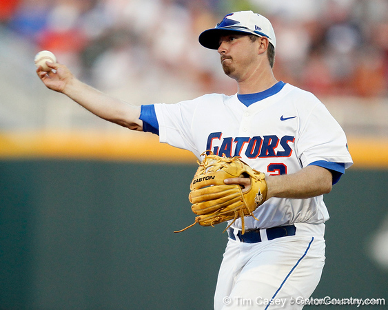 Florida senior Josh Adams throws to first base during the Gators' 8-4 win against the Texas Longhorns in the College World Series on Saturday, June 18, 2011 at TD Ameritrade Park in Omaha, Neb. / Gator Country photo by Tim Casey