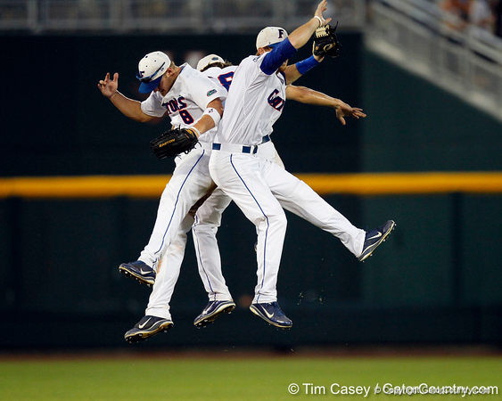 Daniel Pigott, Bryson Smith and Tyler Thompson celebrate after the Gators' 8-4 win against the Texas Longhorns in the College World Series on Saturday, June 18, 2011 at TD Ameritrade Park in Omaha, Neb. / Gator Country photo by Tim Casey
