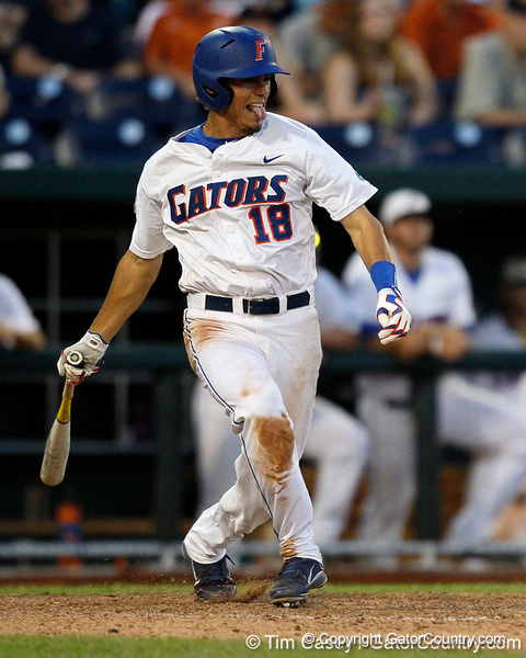 Florida junior outfielder Tyler Thompson follows through on a single during the Gators' 8-4 win against the Texas Longhorns in the College World Series on Saturday, June 18, 2011 at TD Ameritrade Park in Omaha, Neb. / Gator Country photo by Tim Casey