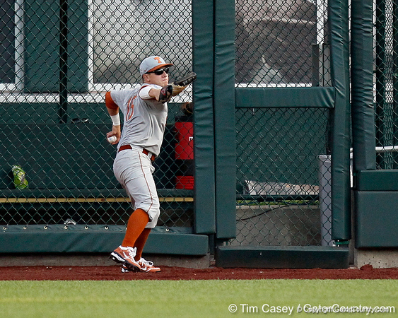 Texas right fielder Mark Payton throws the ball during the Gators' game against the Texas Longhorns in the College World Series on Saturday, June 18, 2011 at TD Ameritrade Park in Omaha, Neb. / Gator Country photo by Tim Casey