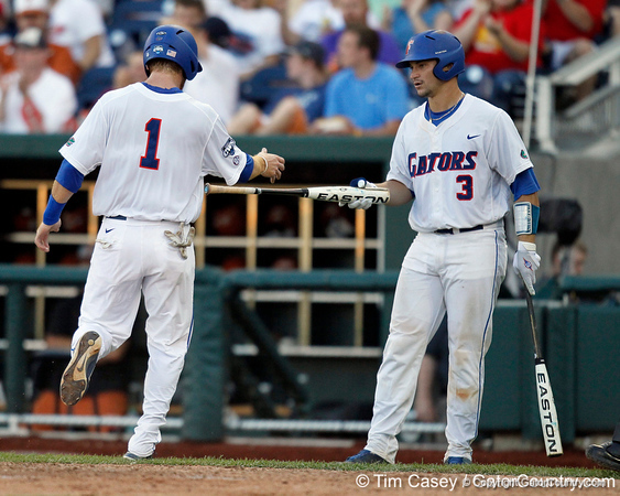 Florida senior Bryson Smith scores during the Gators' game against the Texas Longhorns in the College World Series on Saturday, June 18, 2011 at TD Ameritrade Park in Omaha, Neb. / Gator Country photo by Tim Casey