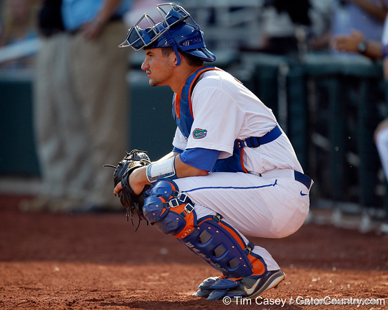 Florida sophomore catcher Mike Zunino stretches during the Gators' game against the Texas Longhorns in the College World Series on Saturday, June 18, 2011 at TD Ameritrade Park in Omaha, Neb. / Gator Country photo by Tim Casey