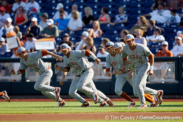 Texas players warm up during the Gators' game against the Texas Longhorns in the College World Series on Saturday, June 18, 2011 at TD Ameritrade Park in Omaha, Neb. / Gator Country photo by Tim Casey
